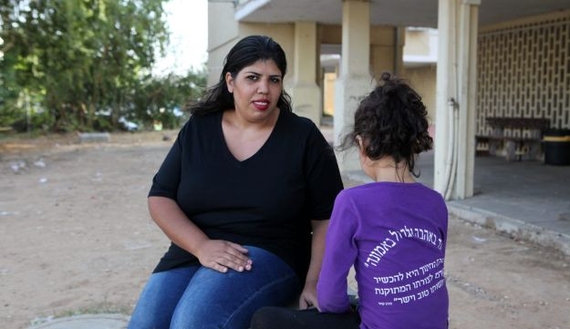 Danielle Or, a single mother of three from Sderot who began studying while receiving welfare, has struggled financially since leaving a battered women's shelter a decade ago.