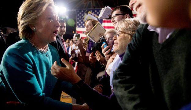 Democratic presidential candidate Hillary Clinton greets members of the audience at a rally at the Cleveland Public Auditorium in Cleveland, Sunday, Nov. 6, 2016.