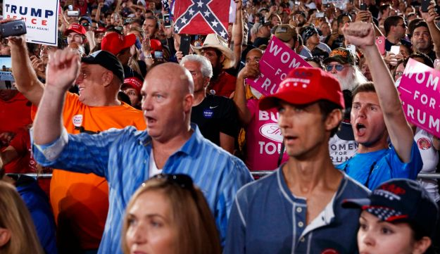 Supporters of Republican presidential candidate Donald Trump cheer during a campaign rally in in Tampa, Florida, on October 24, 2016.
