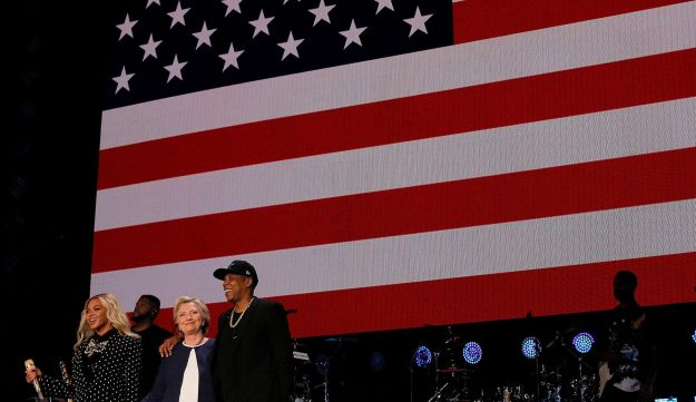 U.S. Democratic presidential nominee Hillary Clinton joins Jay-Z and Beyonce onstage at a campaign concert in Cleveland, Ohio, U.S. November 4, 2016.