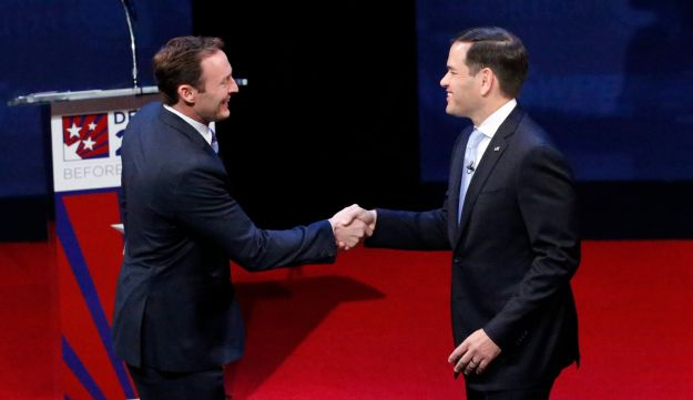 Rep. Patrick Murphy, left, and Sen. Marco Rubio shake hands before the start of a debate, Wednesday, Oct. 26, 2016, at Broward College in Davie, Fla.
