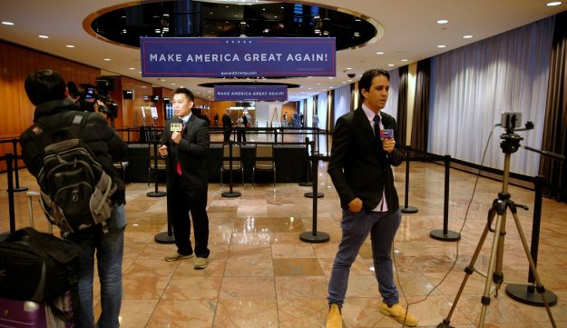 Foreign correspondents file stories outside the ballroom where preparations are taking place for Republican U.S. presidential nominee Donald Trump's election night party in New York, U.S. November 8, 2016.
