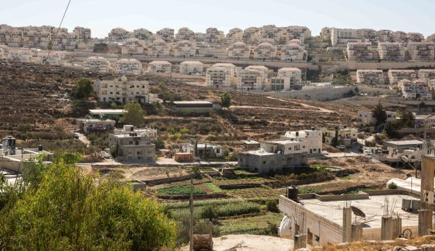The West Bank village of Wadi Fukin with the Israeli settlement of Beitar Illit overlooking it.