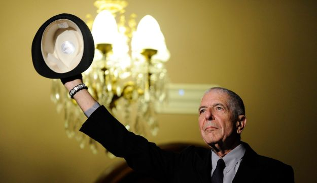 Canadian singer-songwriter Leonard Cohen gestures during a tribute in Gijon, Spain, Oct. 19, 2014.