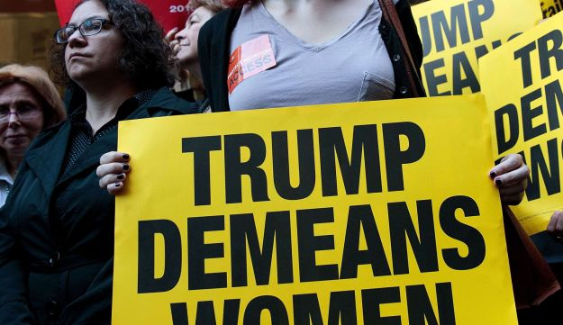 Activists rally during a protest against Republican presidential candidate Donald Trump for his 'treatment of women' in front of Trump Tower on October 17, 2016 in New York City.