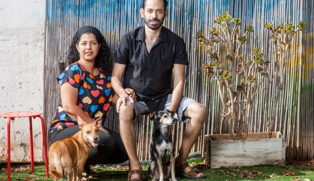 Gili Goldring, right, with his wife Dikla and pet dogs at their home in Gan Yavne.