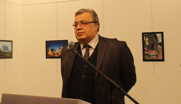 Russia's ambassador to Turkey speaks at an art gallery in Ankara before being fatally shot.