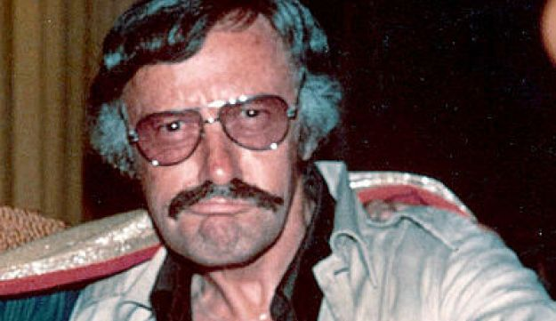 "Photo of Stan Lee at the 1975 San Diego comic con, with the text ""To amazin' Alan - Excelsior! Stan Lee '75""."