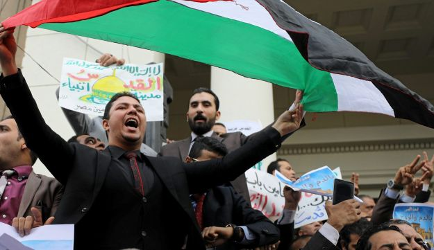 An Egyptian protester carries a Palestinian flag during an anti-Trump and anti-Israel protest at the Lawyers Syndicate in Cairo, December 10, 2017.