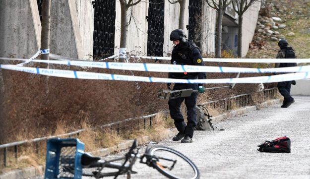 Police officers cordon off the area outside Varby Gard metro station, where two people were injured in an explosion, in Stockholm, Sweden, January 7, 2018.