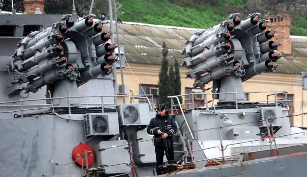 A sailor guards a Russian navy ship in Sevastopol, Crimea.