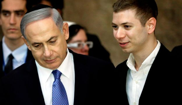 This file photo taken on March 18, 2015 shows Israeli Prime Minister Benjamin Netanyahu and his son Yair visiting the Western Wall in Jerusalem.