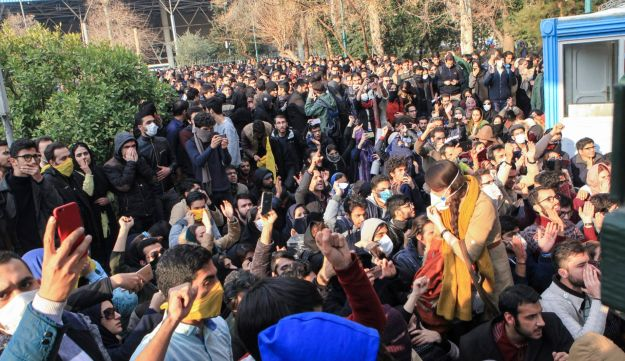 Iranian students attend a protest inside Tehran University while anti-riot Iranian police prevent them to join other protesters, in Tehran, Iran, December 30, 2017.
