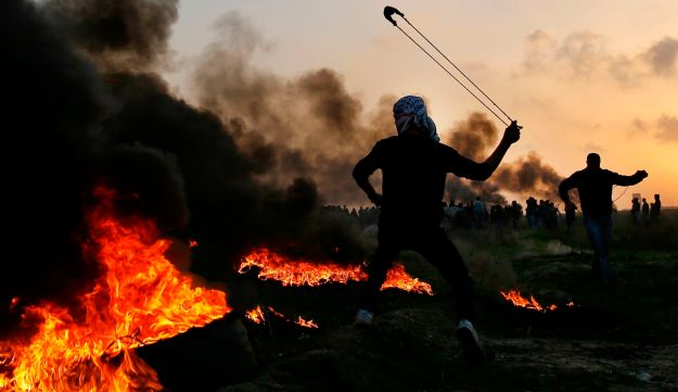 Palestinian protesters clash with Israeli security forces on the eastern outskirts of Gaza City, near the border with Israel, on January 12, 2018.