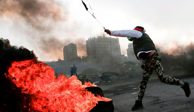 Palestinian protesters clash with Israeli forces on January 12, 2018 north of Ramallah in the Israeli-occupied West Bank.