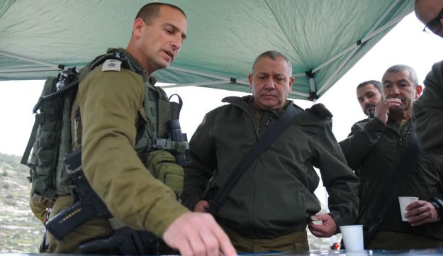 Israel Defense Forces Chief of Staff Lt. Gen. Gadi Eisenkot, center, being briefed by Col. Gilad Amit, commander of the Samaria Brigade, following the murder of Rabbi Raziel Shevach, January 18, 2018.