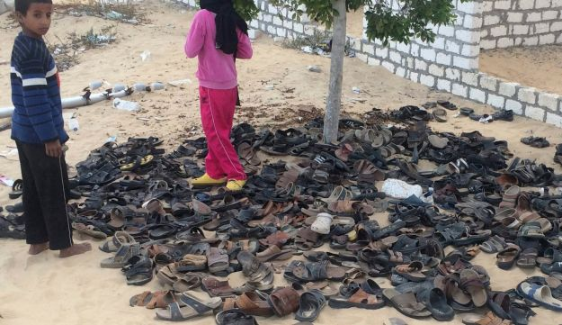Discarded shoes of hundreds of victims outside Al-Rawda Mosque in Bir al-Abd, northern Sinai, Egypt, a day after the deadliest attack by Islamic extremists in the country's modern history. ISIS affiliates were responsible. Nov. 25, 2017