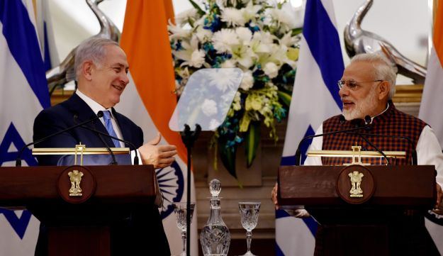 Indian Prime Minister Narendra Modi (R) speaks as Israeli Prime Minister Benjamin Netanyahu looks on during a press conference at Hyderabad House in New Delhi on January 15, 2018.