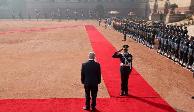 Israeli Prime Minister Benjamin Netanyahu inspects an honor guard at his ceremonial reception in New Delhi, India, January 15, 2018.