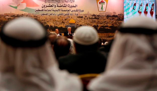 Palestinian president Mahmoud Abbas (C) speaks during a meeting in the West Bank city of Ramallah on January 14, 2018.