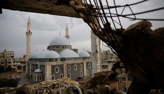 A reconstructed mosque is framed by damaged buildings in the old city of Homs, Syria on January 17, 2018.