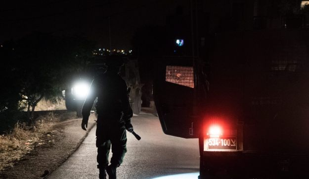 FILE PHOTO: Security forces in the West Bank in 2016.