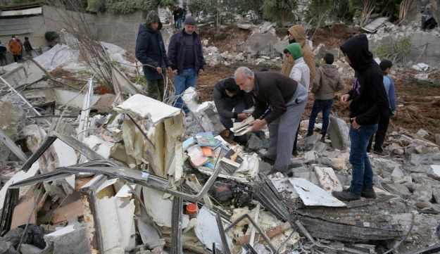 People look through the rubble of the house of Palestinian gunman Ahmed Jarrar following Israeli military operations in the West Bank city of Jenin on January 18, 2018.