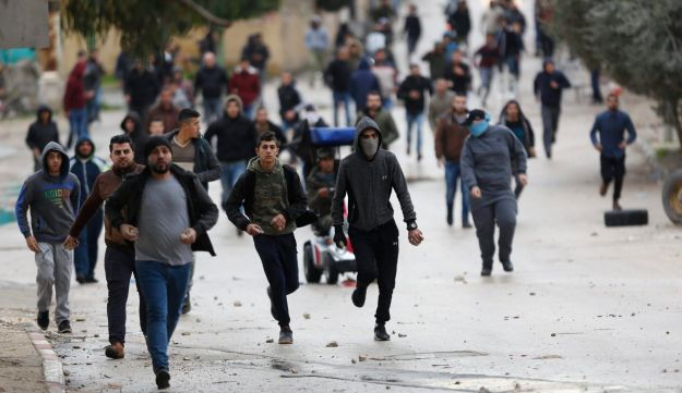 Palestinians clash with Israeli troops in the West Bank city of Jenin on January 18, 2018.