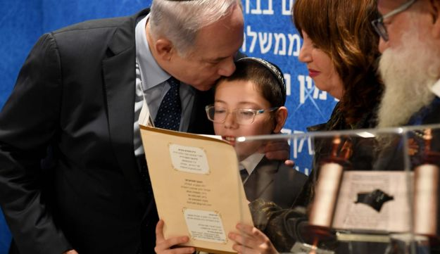 Netanyahu and Moshe Holtzberg at the ceremony commemorating a decade since the attack that claimed the lives of Moshe's parents.