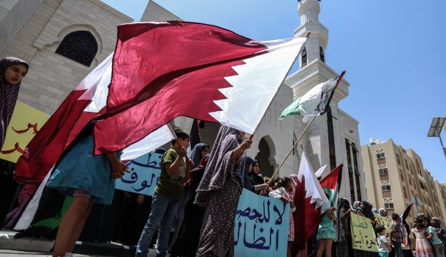 A group of Palestinian women holding Qatar flags and banners during a demonstration in support of Qatar, in Khan Yunis, Gaza, June 14, 2017.