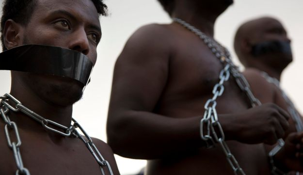 Eritrean migrants wear chains in protest of the Israeli government's intention to forcibly deport African refugees and asylum seekers from Israel on January 17, 2018.