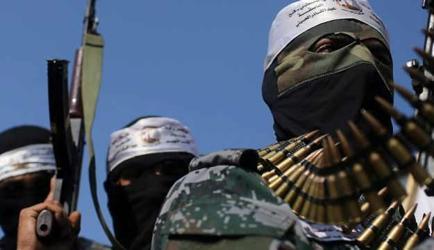 Hamas militants attend a funeral in the Gaza Strip, January 12, 2018.