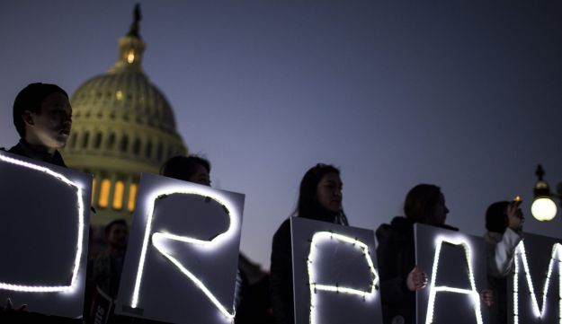 Demonstrators hold illuminated signs during a rally supporting the Deferred Action for Childhood Arrivals program (DACA), or the Dream Act, outside the U.S. Capitol building. Washington, D.C. Jan. 18, 2018