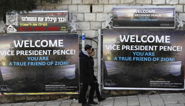 Men walk past welcoming billboards in Jerusalem ahead of the visit of U.S. Vice President Mike Pence to Israel. January 21, 2018