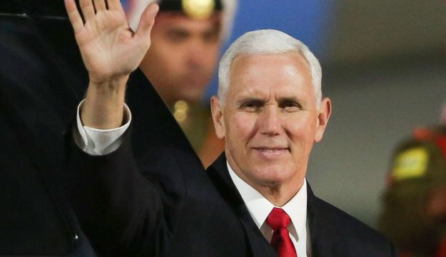 US Vice President Mike Pence waves after leaving Air Force Two upon his arrival in the Jordanian capital Amman, late on January 20, 2018