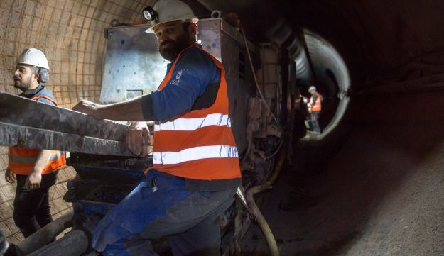Workers inside the Yael tunnel, currently under construction.