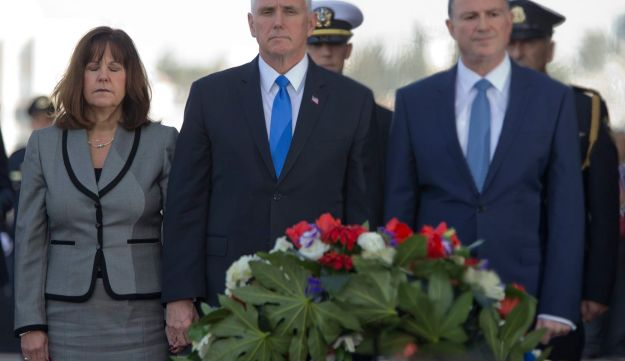 Pence, center, lays a wreath at the memorial for fallen solider in Israel's parliament in Jerusalem, Monday, January 22, 2018.