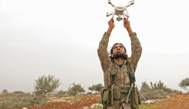 A Turkish-backed Syrian rebel fighter uses a drone at a monitoring point near the Syrian village of Qilah, in the southwestern edge of the Afrin region close to the border with Turkey, on January 22, 2018
