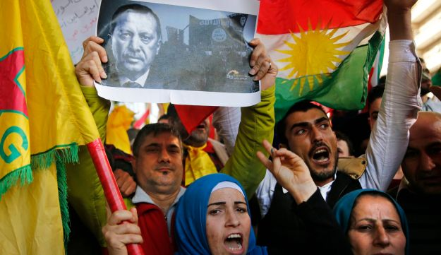 Kurdish demonstrators holding Kurdish flags and a picture of the Turkish president protest against the operation by the Turkish army aimed at ousting the U.S.-backed Kurdish militia from the area in Afrin, Syria, at the Russian embassy, in Beirut, Lebanon, Monday, Jan. 22, 2018. The Turkish offensive on Afrin, codenamed Operation Olive Branch, started Saturday and has heightened tensions in the already complicated Syrian conflict, threatening to further strain ties between NATO allies Turkey and the United States. (AP Photo/Hussein Malla)