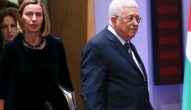 European Union foreign policy chief Federica Mogherini and Palestinian President Mahmoud Abbas arrive for a lunch with EU foreign ministers at the EU Council in Brussels. Jan. 22, 2018