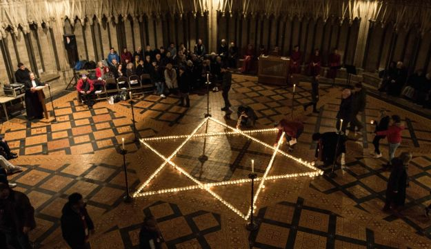 600 lit candles in the shape of the Star of David centered a Holocaust Memorial Day 2018 ceremony at York Minster January 24, 2018. The service included Evensong and Kaddish, the Jewish Mourner's Prayer