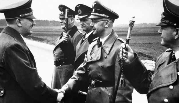 Adolf Hitler, left, shaking hands with German Interior Minister and head of the SS, Heinrich Himmler, somewhere in Germany, 1944.