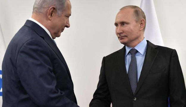 Russian President Vladimir Putin meets with Israeli Prime Minister Benjamin Netanyahu at the Jewish Museum and Tolerance Centre in Moscow on January 29, 2018