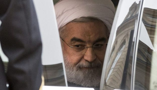 Hassan Rouhani, Iran's president, prepares to alight from an automobile as he arrives for a meeting with France's President Francois Hollande at Elysee Palace in Paris, France, on Thursday, Jan. 28,