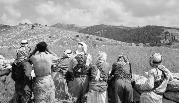Arab fighters scan the hills of the Bab El Wad area on May 10, 1948. Arab and Jewish Forces clashed in a battle for control of the Tel Aviv-Jerusalem highway in Palestine.