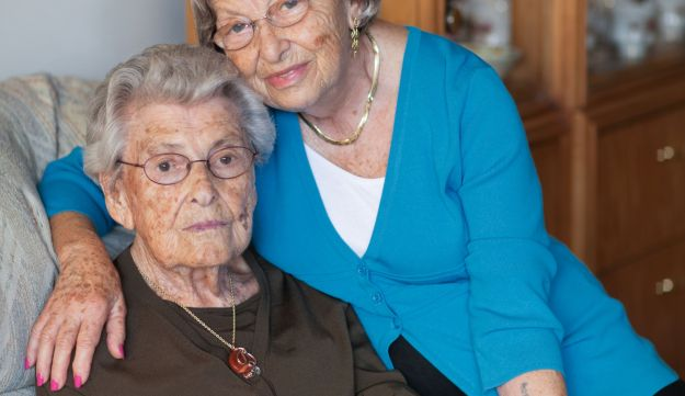 Ella Weiss, 100, sitting with her daughter Eva Gross, 83. Ella passed away shortly after the image was taken.