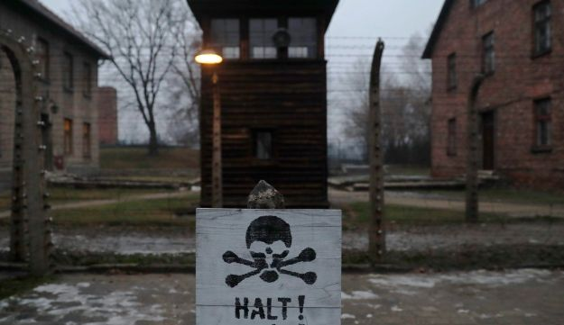 "A sign reading ""Stop!"" in German and Polish at the former Nazi death camp of Auschwitz, during an International Holocaust Remembrance Day ceremony, in Poland, January 27, 2018."