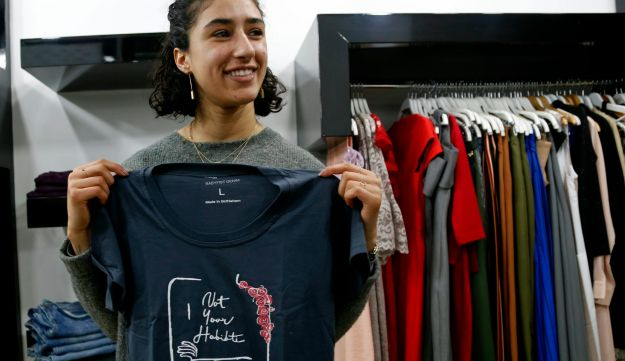 Palestinian-American Yasmeen Mjalli holds one of her T-shirt designs with the slogan 'Not Your Habibti.'