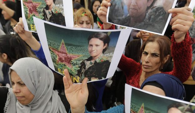 Lebanese-Kurds hold pictures of late 23-year-old Kurdish People's Protection Units (YPJ) fighter Barin Kobani following her grisly killing, February 5, 2018.