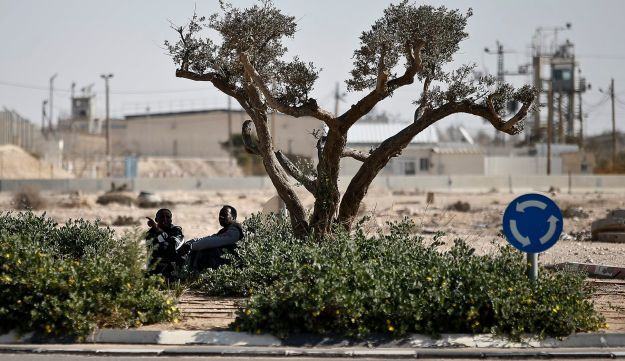 African asylum seekers outside the Holot detention facility in the Negev, in southern Israel, Feb. 3, 2018.